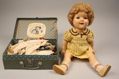 1930s era Shirley Temple doll w/original clothes. Yep...I had the clothes chest and many outfits.