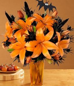 This is a design using typical Halloween colours of orange and black. This is not one of the busiest times for a florist but Halloween is becoming more popular in this country. The florist has added the small bat to finish the design. Liliums are not cheap so I think this modern design is approx £40.