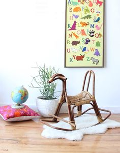 For the modern playroom: a rattan rocking horse. Childrens Rocking Horse, Rocking Horses, Modern Playroom, Home Organization Hacks, Activity Toys, Big Girl Rooms, Wicker Furniture, Infant Activities, Wishbone Chair