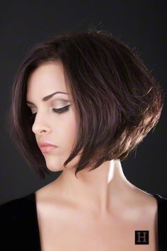 Women's medium length bob hairstyle, with chocolate brown hair color and without bangs.