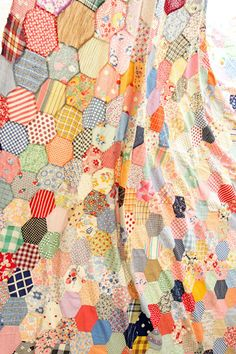 vintage quilt--I think I could do these large hexies for Grandmother's Flower Garden...or maybe just random hexies like this.  More manageable.