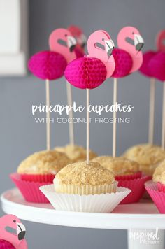 Pineapple Cupcakes with Coconut Frosting! Don't worry about the cakes I want the flamingo decorations!!!