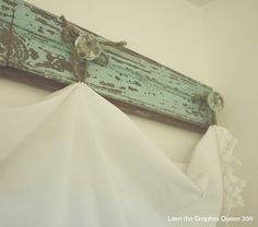 Great idea for hanging curtains. Throw some purty knobs on a cool piece of paneling. Voila!