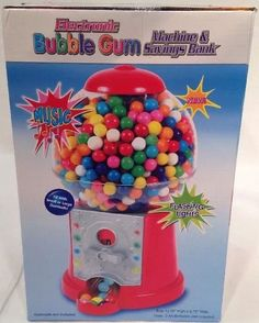 "New in box. Music & flashing lights. Uses 3 AA batteries (not included), fill with small or large gumballs (gumballs not included). 12.50"" high, 6.75"" wide. As seen on TV. 
