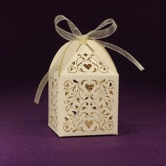 What better way to express gratitude towards your guests, than by treating them to your favorite treat, enclosed in one of these wedding favor boxes! Laser cut details of the Love Vines design bring a