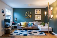 Paint colors that match this Apartment Therapy photo: SW 0009 Eastlake Gold, SW 7018 Dovetail, SW 7027 Well-Bred Brown, SW 9185 Marea Baja, SW 6240 Windy Blue