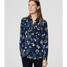 LOFT Valley Floral Bow Blouse ($60) ❤ liked on Polyvore featuring tops, blouses, amazon navy, bow blouse, wrap tops, neck tie blouse, long sleeve wrap top and bow tie neck blouse
