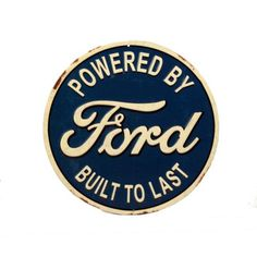'Powered by Ford built to last' round Tin Sign⎜Open Road Brands