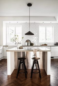 i like the little hit of stainless steel--maybe not use stainless but how can you add a little texture/complimentary colors? Renovation Inspiration: 10 Beautiful Kitchens with No Upper Cabinets Crisp Kitchen, Kitchen Dining, Kitchen Decor, Kitchen Island, Nordic Kitchen, Kitchen White, Timber Kitchen, Warm Kitchen, Kitchen Floors
