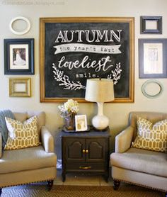 Chalkboard quote and lettering.  Neutral lamp and stand on a darker piece with gold hardware.