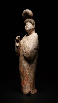 COURT LADY WITH TALL HAIR BUN Terracotta with painting. China, Tang Dynasty (618 - 905)