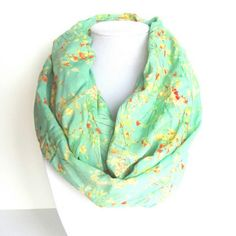 Is it spring like weather where you are?   This lovely colored scarf was just added to our shop for our spring collection! Mint and coral in a delicate floral print. Oh so soft and light weight.