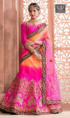 Winsome Orange And Pink A Line Lehenga Choli Orange and pink art silk a line lehenga choli with beads work enhances the embroidered floral patterns and classic human motifs on lehenga