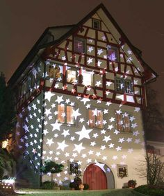 This Rheineck, Switzerland, home creates a striking generic display to accommodate all winter holidays. A star-patterned cap over a massive floodlight covers the exterior with sparklers in a creative way.