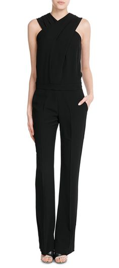Forego your usual black dress and opt for this slick jumpsuit from Victoria, Victoria Beckham. The tapered legs and immaculate draping make it a flattering and timeless choice #Stylebop