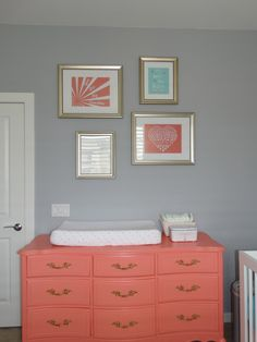 We love this coral refinished Vintage Dresser & Changing Table! {Painted with Benjamin Moore Coral Gables} #nursery #changingtable #coral