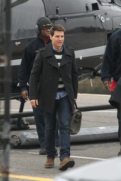 Tom Cruise with old time favorite Filson Original briefcase otter green