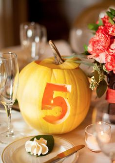 Pumpkin table number- unique way to incorporate pumpkins into a Fall wedding!