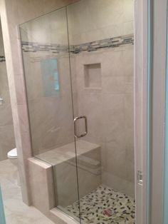 Small Walk In Shower a walk in shower is filled with a mix of marble shower tiles lined