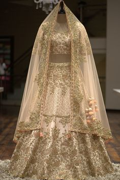 Light Beige Raw Silk Sequins Embroidered Bridal – Stylizone A beautiful blush pink gown with a heavily embellished bodice in pearls, beads, and sequins on the front and back. The gown has an irregular pearl spray, highlighting the outfit. Bridal Lehenga Online, Designer Bridal Lehenga, Indian Bridal Lehenga, Lehenga Wedding, Gown Wedding, Bridal Sarees, Punjabi Wedding, Lace Wedding, Indian Bridal Outfits