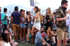 In the thick of it: The model led the way through the crowded site which was filled with festival-goers chilling out on the grass