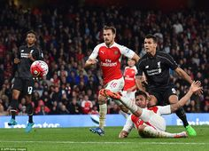 Giroud could only flick the ball towards goal as he lost his footing on the Emirates Stadi...