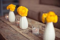simple centerpiece with candles we could get cheap little vases from dollar store and paint white/gold. with a red or blue artificial flower