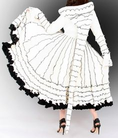 I love all the coats by Enlightened Platypus, especially this bridal fairy coat in white and black! MonaRaeBeads.etsy.com