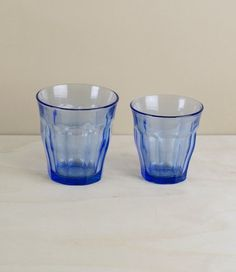 Picardie Marine - Boxes of 6 of these classic tumblers with a blue twist. First designed in 1927 and produced since 1945 using Saint-Gobain's patented glass tempering method, during which each glass is heated to about 700°C and cooled rapidly in blasts of cold air. With a curving, tapering, nonagonal shape, formed to mimic the space inside a lightly closed fist the Picardie has been much copied, but never it seems improved, perhaps because they imitate the form without understanding its…