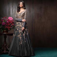 A grey raw silk gown with peeta, zardosi and encrustations, for an glimmering reception.
