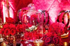 Iconic glass domed rose centerpiece at a modern fairy tale wedding reception