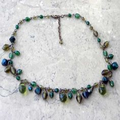 Imagine green dropper bead necklace for sale Modern strand green beads of lime olive dark and just mid green colors Dark brass metal chain