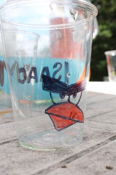 Angry Bird Party:  i bought basic plastic cups.  using sharpies i drew on the kid's name on one side (in Angry Bird font) and then drew on eyes and beak from the different birds.  (or you could also eyes and snout from pigs.)  then the juice would color the cup and give the face it's color.