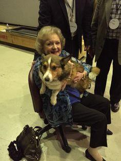 Betty White holding Bandit the Corgi!