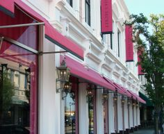 """Pink pops of Sunbrella are everywhere!  Check out this fashion statement… Victoria's Secret uses Sunbrella's Mayfield Collection Pink awning fabric to bring their """"Pink"""" Brand to the public."""