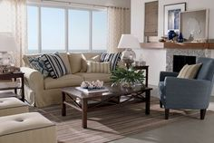 COASTAL SHORE CREATIONS: Navy and White Coastal Living Rooms   Love the opposing stripe pillows!