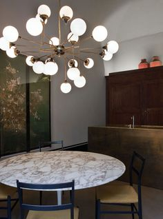 Dimore Studio-Milano. A beautiful light fixture that doubles as art. Doesn't it look smart?