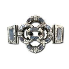 Scottish Montrose Agate Bracelet. This is a spectacular Scottish silver multi-hinged bracelet set with beautiful Montrose agate with a central looping quatrefoil motif finished with hand engraved scrolling foliate motif. This bracelet measures 6 3/4 long by 1 3/4 wide at the widest point.