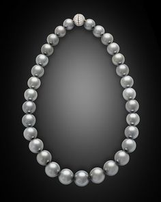 Thirty-one perfectly matched silver pearls from the waters of Tahiti glow with dramatic radiance in this stunning necklace. Rare among Tahitian black pearls for their light, silvery hue, these enchanting gems of the sea range in size from 12mm to a remarkable 14.9mm. Their size, color and eye-catching luster place them among the finest pearls in the world; to find them so beautifully matched in a necklace is truly outstanding.<br><br>Prized for their luminous coloring, black pearls hailing…