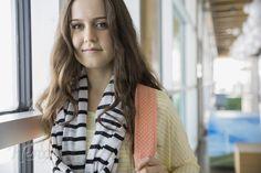 Portrait of confident high school student in corridor -