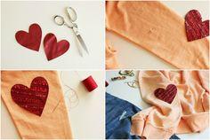 Die roten glänzenden Herzchen erfrischen den einfachen Pullover
