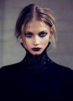 Vampy lips with dark navy smokey eyes makeup for charming evening look.