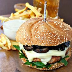 A juicy grilled chicken hamburger topped with cheese and sauteed marsala mushrooms.