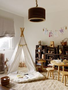 eclectic kids by Jute Interior Design - Like the teepee with the flokati rug and the little woodland touches in the room.