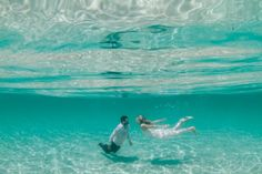 Claire & Chris. Underwater wedding photo session in the crystal clear waters of Eagle Bay.underwater photo underwater model underwaterwedding underwater photoshoot beach wedding ocean wedding tropical wedding