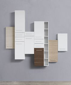 Mix and match colours, heights of wall units and tall units.