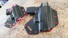 Kydex behind the back holsters. sweet