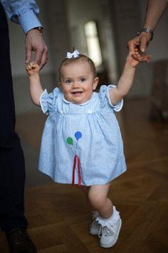 Princess Estelle of Sweden wearing Crown Princess Victoria's old baby dress.