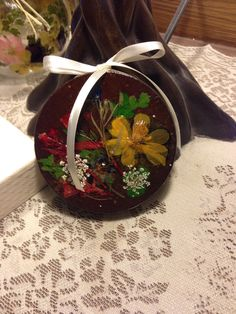 "Old lid decorated w real pressed flowers-""Denise"""