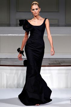 Oscar de la Renta - hate the shoulder bow, but love the fitted bodice and the way the sleeves go a little off the shoulder
